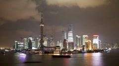Illuminated Pudong skyline,  Huangpu River, Shanghai, China, T/Lapse - stock footage
