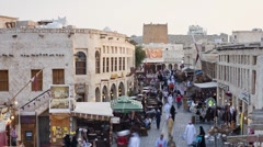Restored Souq Waqif, mud rendered shops, exposed beams, Qatar, T/Lapse - stock footage