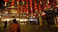 Lanterns hanging in Yuyuan Bazaar district at night, Shanghai, T/Lapse - stock footage