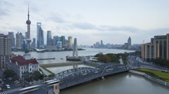 Pudong skyline & the Waibaidu (Garden) Bridge, Shanghai, T/Lapse - stock footage