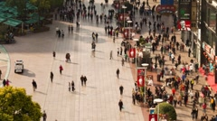 Pedestrians walking past stores on Nanjing Road, Shanghai, China, T/Lapse Stock Footage
