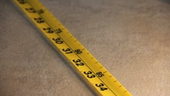 Measuring Tape being rolled up - stock footage
