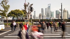 People crossing busy road in front of the new Pudong skyline, Shanghai, T/Lapse - stock footage