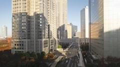 Morning shadows passing over buildings in Shinjuku, Tokyo, Japan, T/Lapse - stock footage