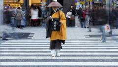 Shinto priest seeking donations (Alms) road crossing, Tokyo, T/Lapse Stock Footage