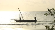 Stock Video Footage of Traditional African Fishing Boats against sunrise on Zanzibar.