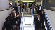 Stock Video Footage of Commuters on a escalator entering Shibuya Station, Tokyo, Japan, T/Lapse