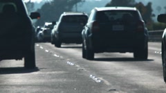 Road level traffic shallow focus Stock Footage