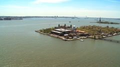 Aerial view of Ellis Island and the Statue of Liberty New York Harbor, USA Stock Footage