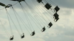 Carnival swings with sky in background Stock Footage