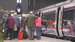 Train Passengers Leaving A Train At Glasgow Queen Street Station Platform  Stock Footage