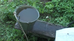 bucket of water next to the well - stock footage