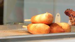 Corndogs sitting under heat lamp - stock footage