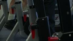 Feet Peddling Exercise Bikes in Gym Stock Footage
