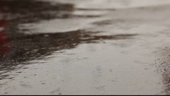 Raindrop splashes on the asphalt Stock Footage