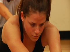 Young Woman Stretching with Intense Face Stock Footage