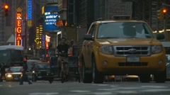 Evening, NYC taxi bike Stock Footage