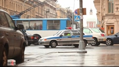 Russian road police car on the crossroad, make turn Stock Footage