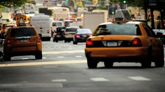 Yellow Cabs and city traffic in busy New York City, Manhattan, USA Stock Footage