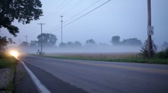 Bright Headlights in Fog on road Stock Footage