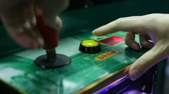 Playing claw game and pressing drop button Stock Footage