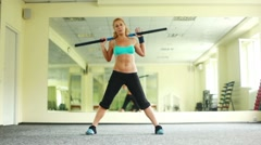 Women is doing exercises with Body Bar. Part 3 of 4. Dolly HD. Stock Footage