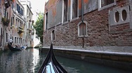 Gondola on canal in Venice Stock Footage