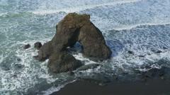 Waves crashing on rocks at shoreline Stock Footage