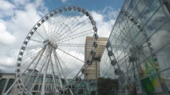 The Manchester Wheel Ferris Wheel Reflected In The Arndale Centre England UK - stock footage