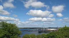 White clouds above Falmouth docks time lapse. Stock Footage