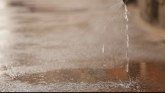 The jet and splashes of rain from the pipe Stock Footage