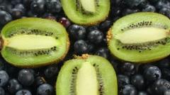 Kiwi Halves On Bed Of Blueberries Stock Footage