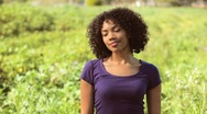 Young woman laughing in field Stock Footage