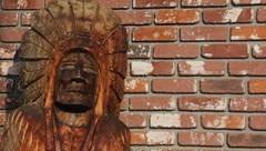 Tobacco Store Indian Against Brick Wall Stock Footage