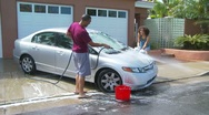 Stock Video Footage of Couple washing car in driveway