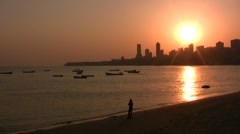 Lonely Indian at captivating Mumbai sunset Stock Footage