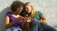 Stock Video Footage of Two women friends playing with cellphones