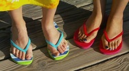 Stock Video Footage of Close-up of women's feet in sandals