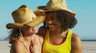 Stock Video Footage of Two women friends at the beach in cowboy hats