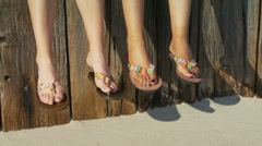 Close-up of women's feet in sandals Stock Footage