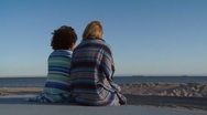 Stock Video Footage of Two women friends sitting at the beach