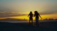 Stock Video Footage of Two women friends running towards the camera at sunset