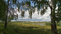Lake by village 2 - stock footage