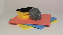 Dishwashing cloths and sponges rotating - stock footage