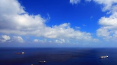 Dark-blue ocean with the ships, the blue sky Stock Footage