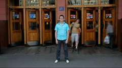 Young man standing at the entrance to the metro. Time-lapse Stock Footage