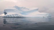 Stock Video Footage of single iceberg floating with reflection, antarctica