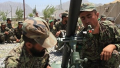 Afghan National Soldiers Working with a Weapon (HD)c - stock footage