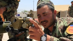 Afghan National Soldiers Loading Weapon (HD)c - stock footage