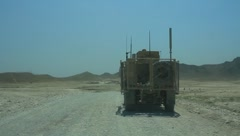 War Vehicles on Afghan Road (HD)c - stock footage